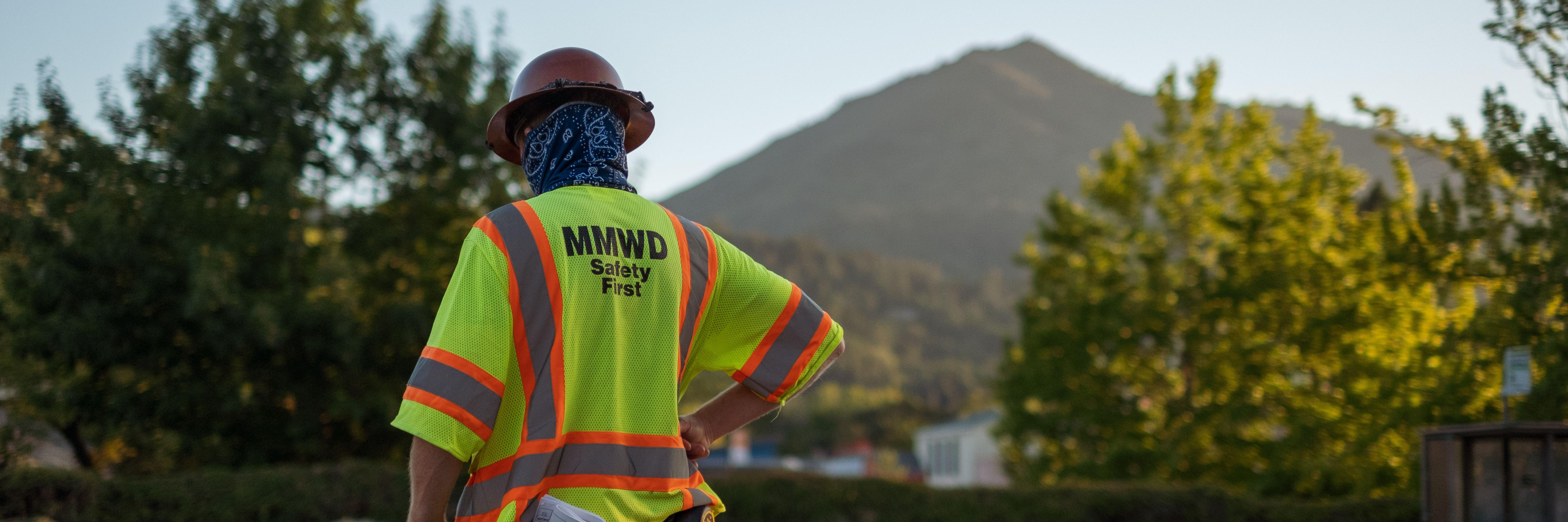 Marin Water employee with view of Mt. Tam in the background.